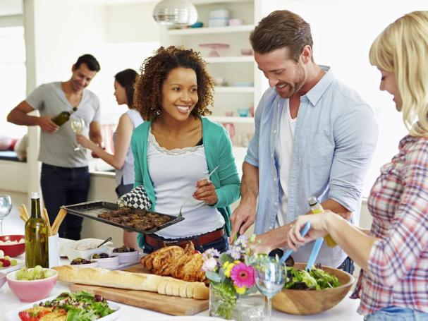 TS-459939037_young-people-cooking-dinner-together.jpg.rend.hgtvcom.1280.960.jpeg